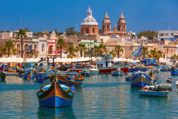 Taditional eyed boats Luzzu in Marsaxlokk, Malta stock photo