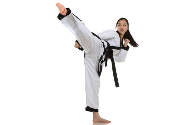 taekwondo side kick - martial arts gerville stock photos and pictures