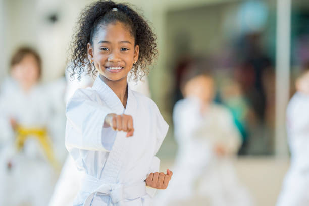 taekwondo student - karate stock photos and pictures