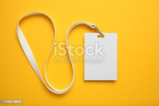 istock Tag id pass, plastic identification on yellow background. White blank badge mockup 1149218932