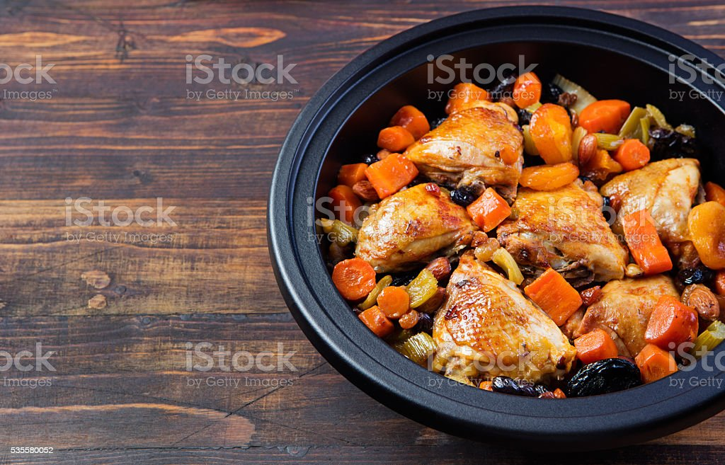 Tagine with cooked chicken and vegetables. Traditional moroccan cuisine. stock photo