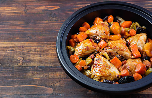 tagine with cooked chicken and vegetables. traditional moroccan cuisine. - braised stock pictures, royalty-free photos & images