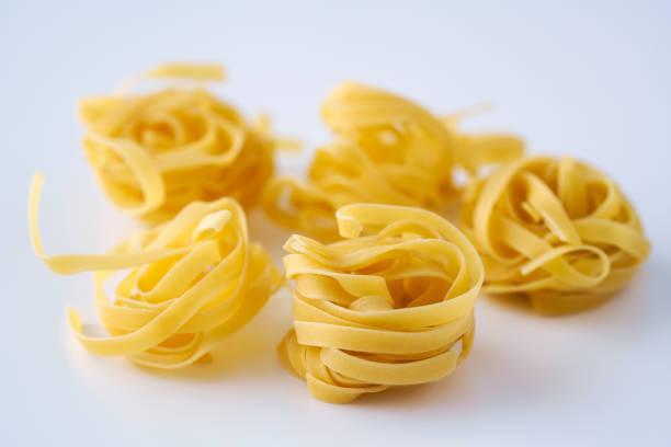 Tagliatelle 103 on the white.Pasta stock photo