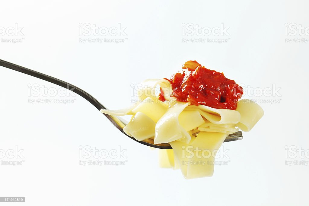 tagliatelle and bolognese sauce on a fork stock photo