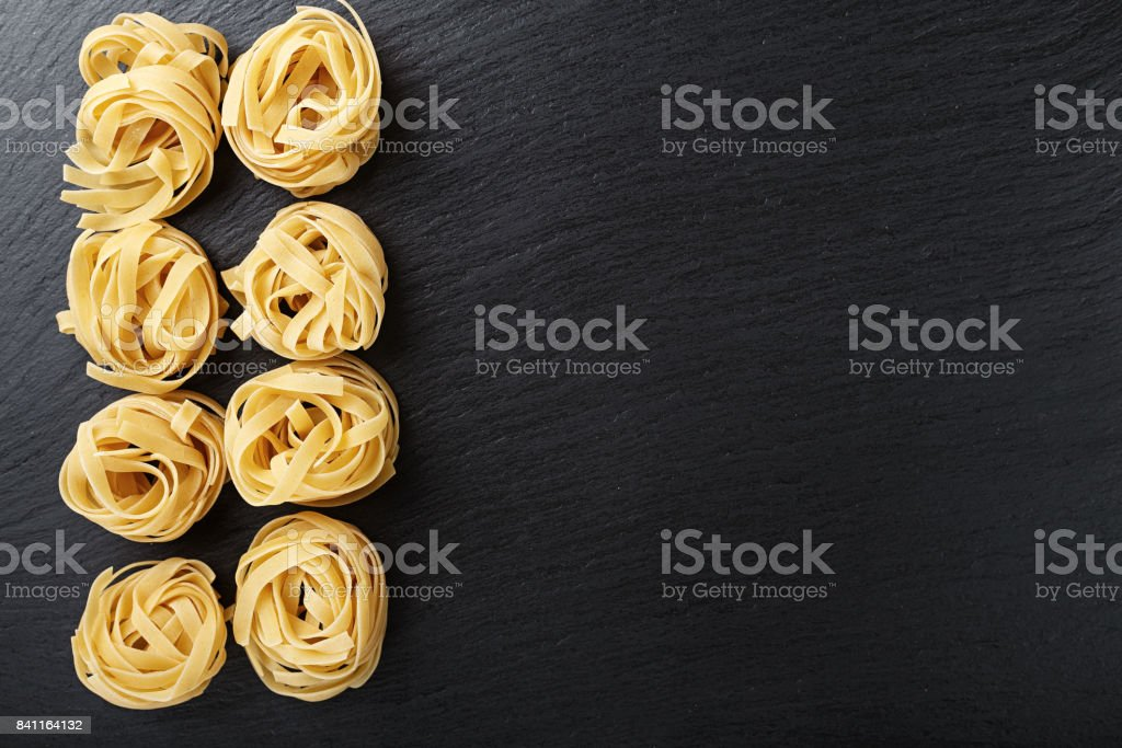tagliatelle pasta on a black background stock photo