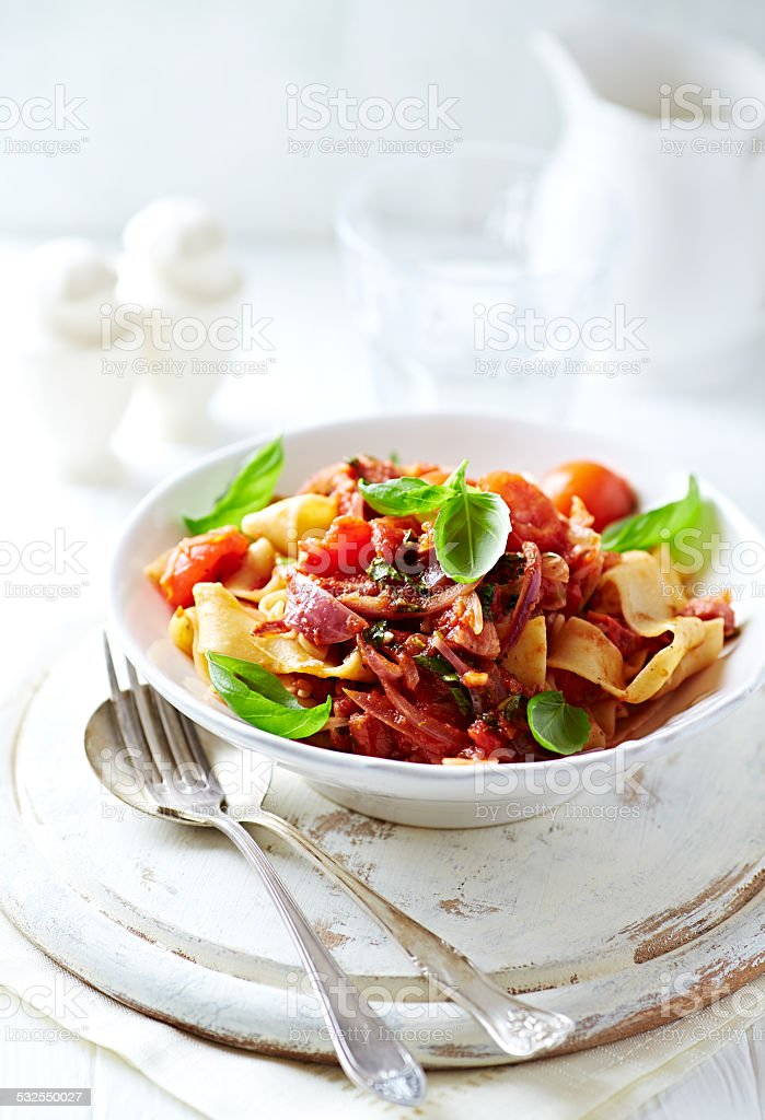 Tagliatelle pasta with cherry tomatoes and fresh basil stock photo