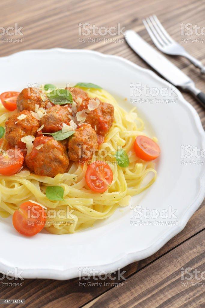 Tagliatelle pasta with meatballs royalty-free stock photo
