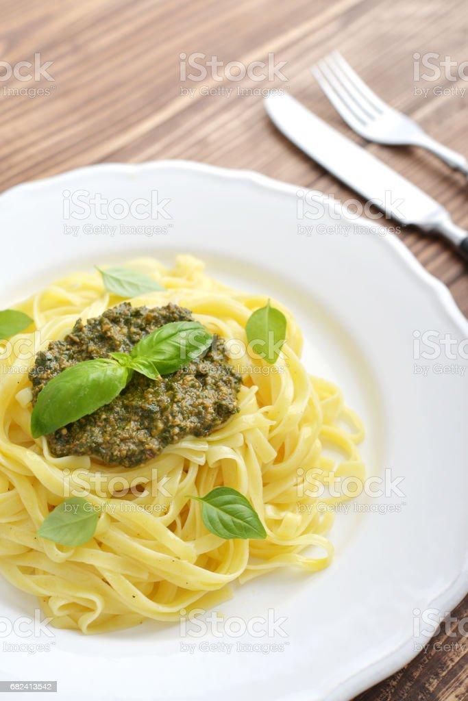Tagliatelle pasta with pesto sauce royalty-free stock photo