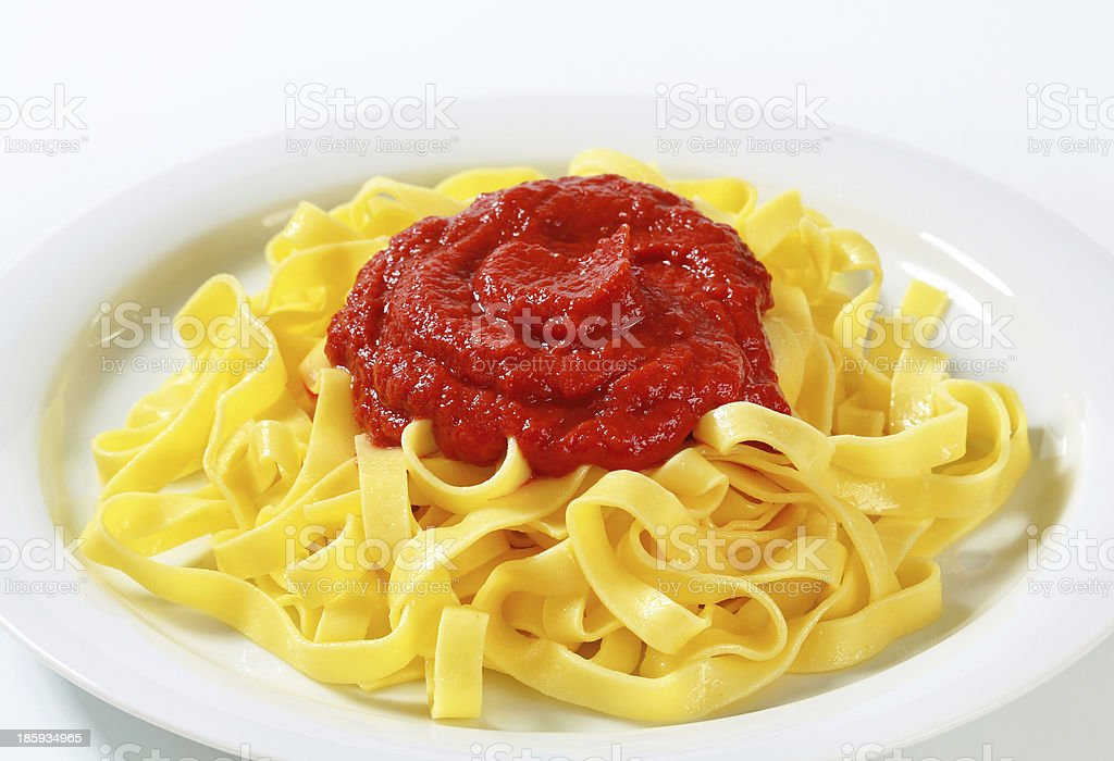 Tagliatelle pasta with tomato paste royalty-free stock photo