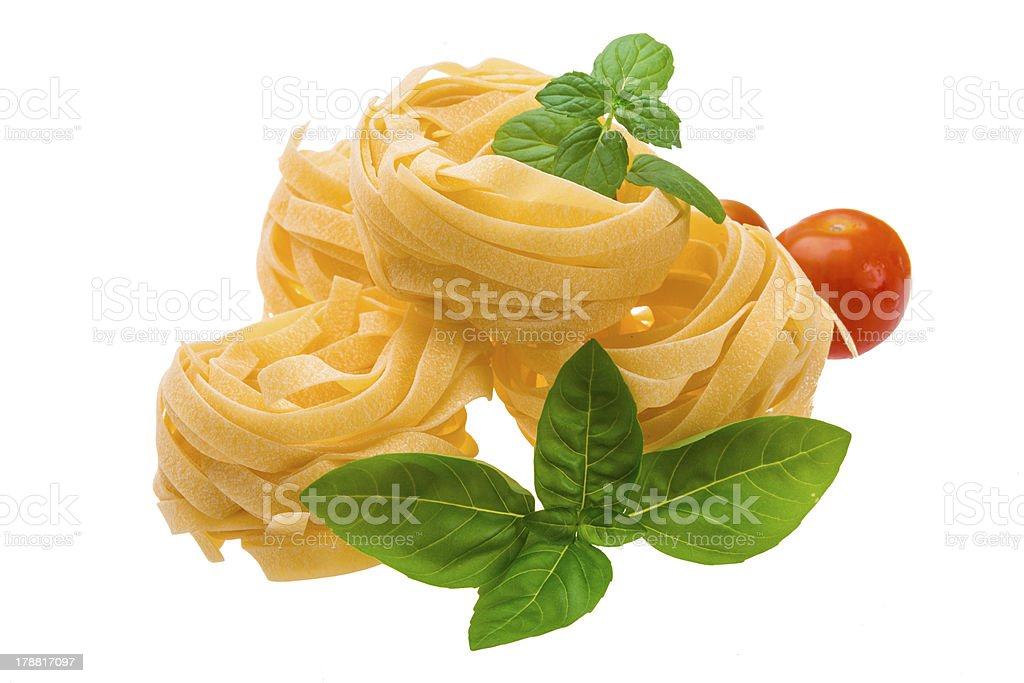 Tagliatelle with basil, tomato and mint royalty-free stock photo