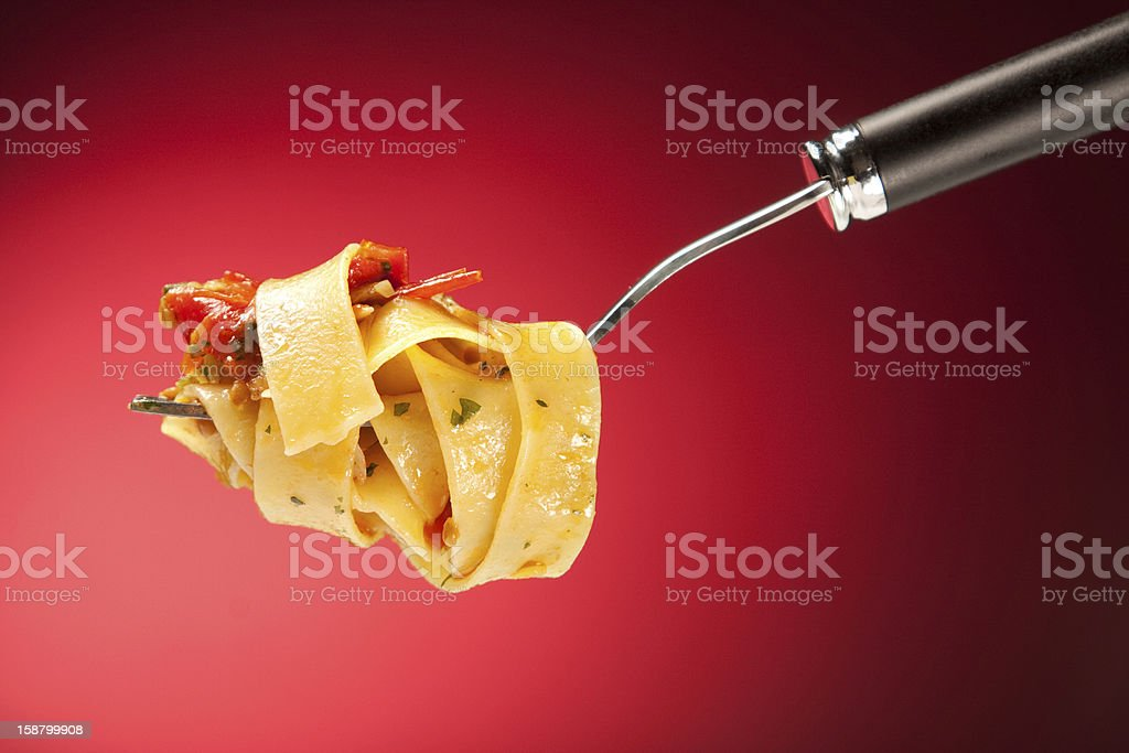 Tagliatelle with clams on a red background stock photo