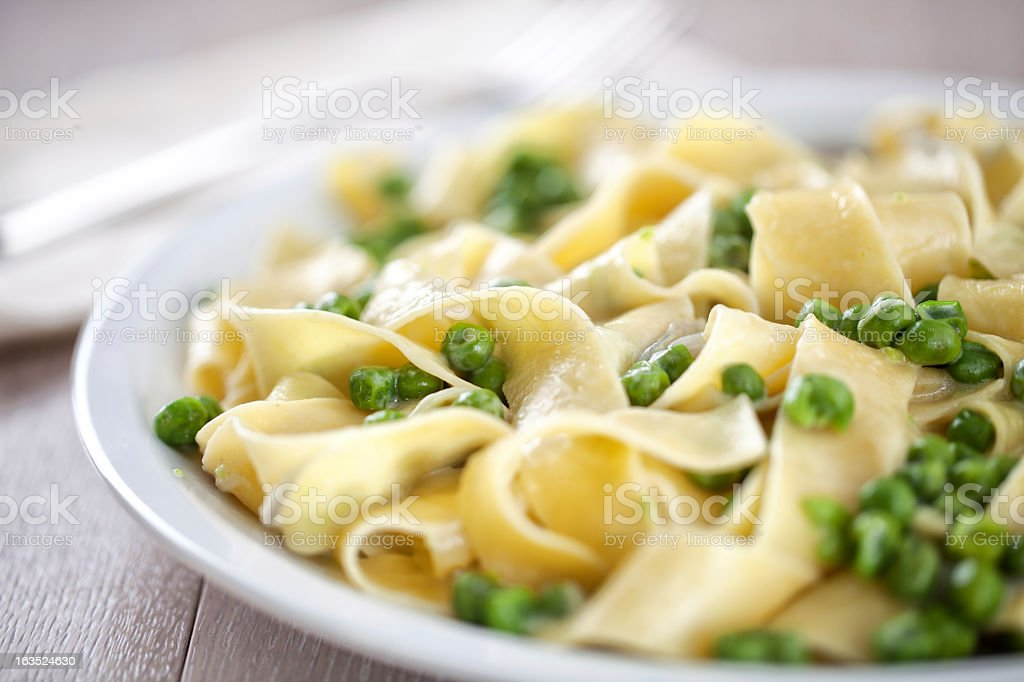 Tagliatelle with cream and peas stock photo