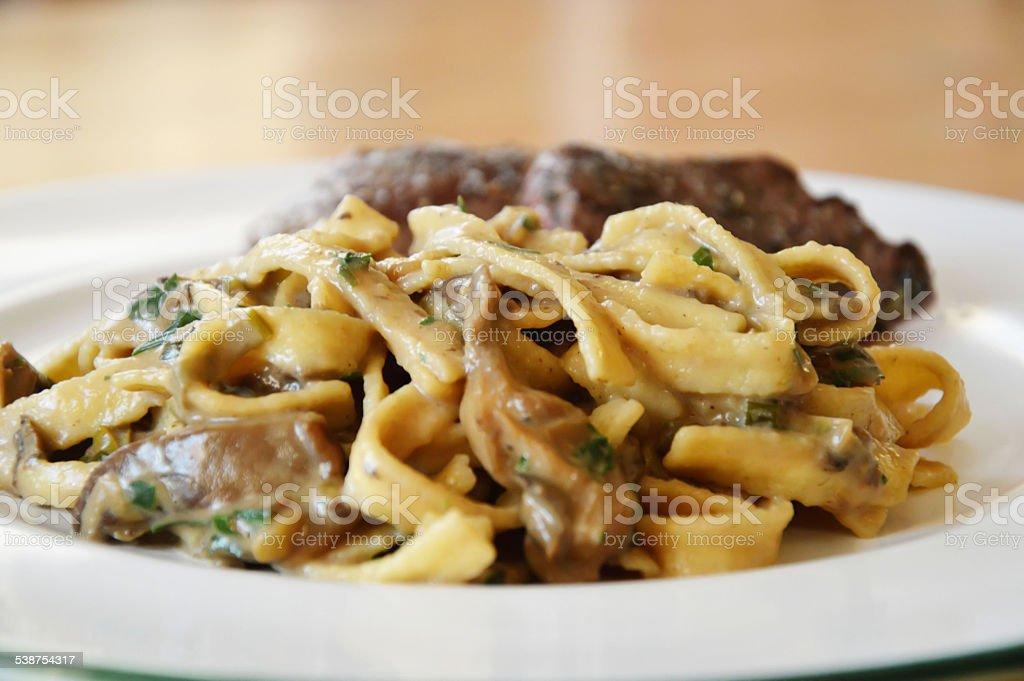 Tagliatelle with mushrooms stock photo