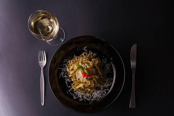 Tagliatelle with pesto sauce stock photo
