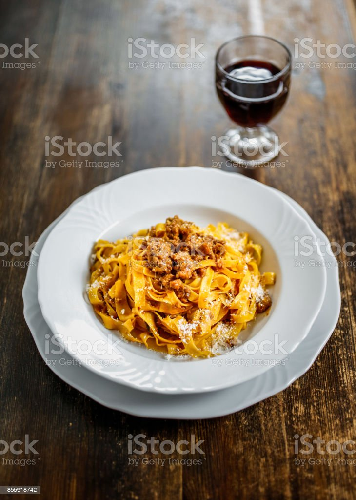 Tagliatelle with ragù. Tipycal homemade fresh pasta with meat  sauce. stock photo