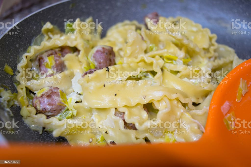 tagliatelle with sausage and vegetables stock photo
