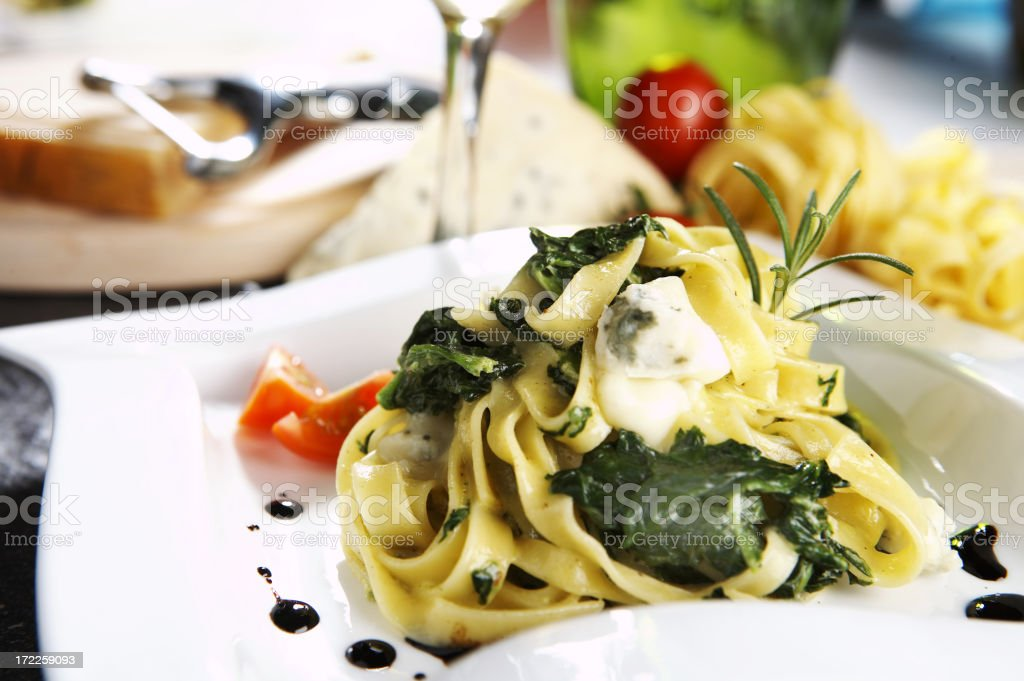 Tagliatelle with spinach stock photo