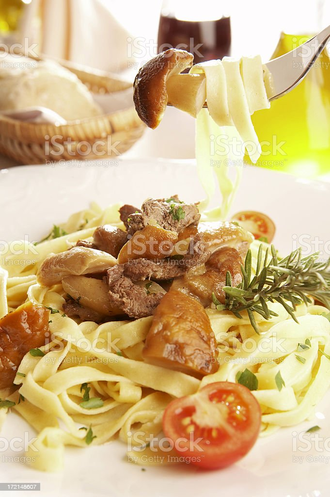 Tagliatelle with wild mushrooms royalty-free stock photo