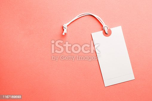 Tags for the price and labels for clothes. White tag mock-up on a orange coral background. Copy space for text