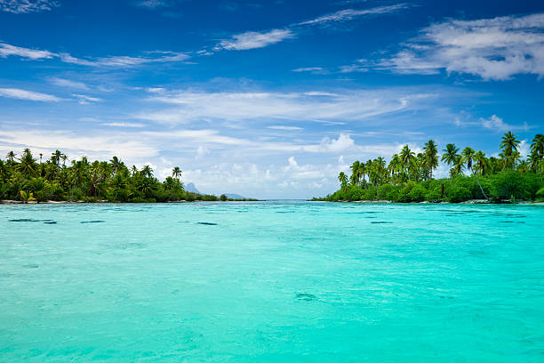 Taha'a Island Exotic Lagoon South Pacific View over beautiful turquoise lagoon with small and lonesome islands. South Pacific, French Polynesia. south pacific ocean stock pictures, royalty-free photos & images
