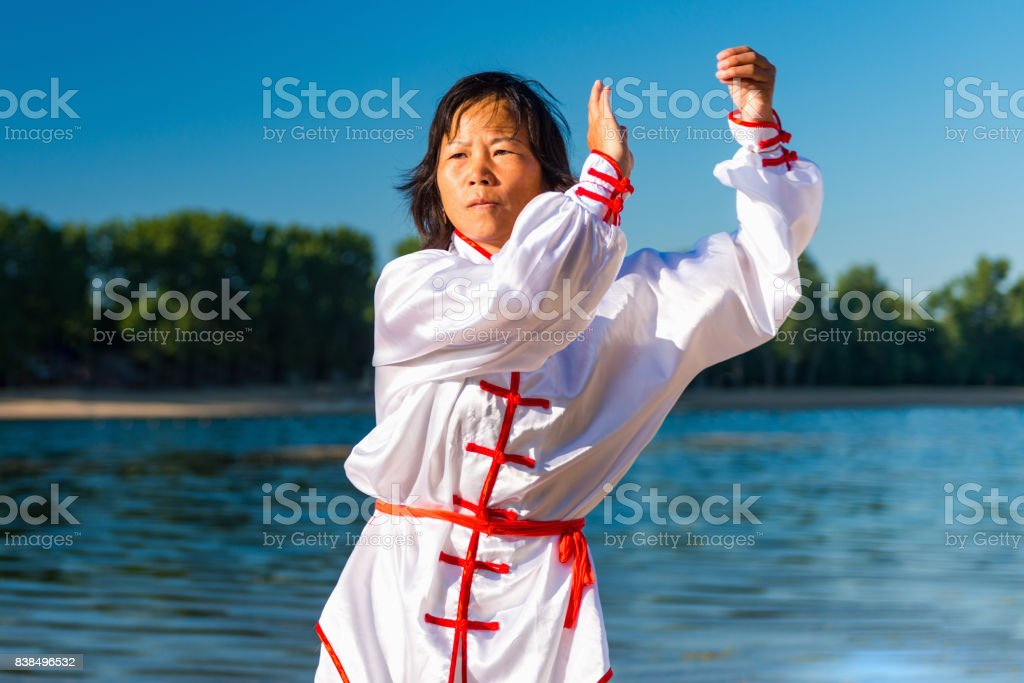 Tai Chi by the water stock photo