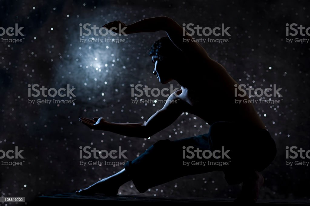 tai chi man against starry sky at night stock photo