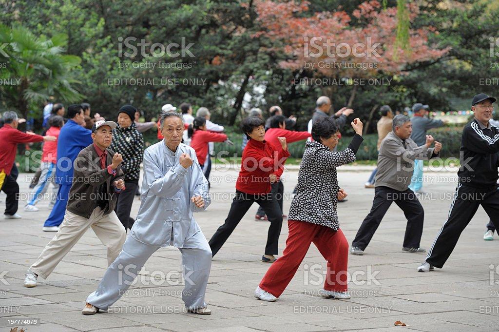 Tai Chi practice in park stock photo