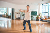 Young man practicing tai chi empty hand in his studio.