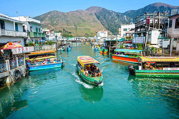 Tai O is a fishing town Hong Kong - February 13, 2015: Tourist are visiting by pleasure boat in Tai O. Tai O is a fishing town, located on the western side of Lantau Island in Hong Kong. new territories stock pictures, royalty-free photos & images