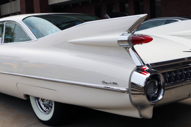 Tail fins on a 1959 Cadillac Sedan de Ville Flint, Michigan-December 30, 2017:  1959 Cadillac Coupe de Ville.  This model represents the high point of American car design and luxury. ville stock pictures, royalty-free photos & images
