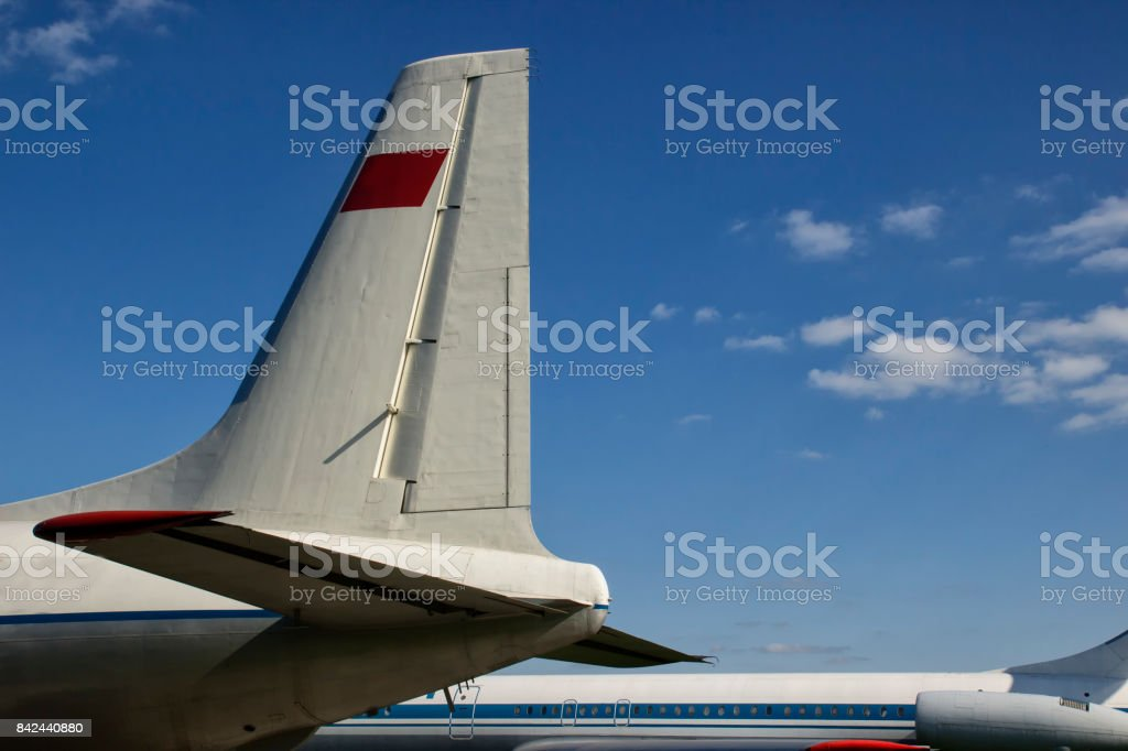 Tail of an airplane, airport stock photo