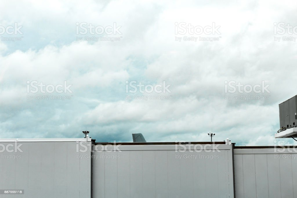 Tail of an airplane seen over a jetway at Boston Logan Airport, May 15 2017 stock photo