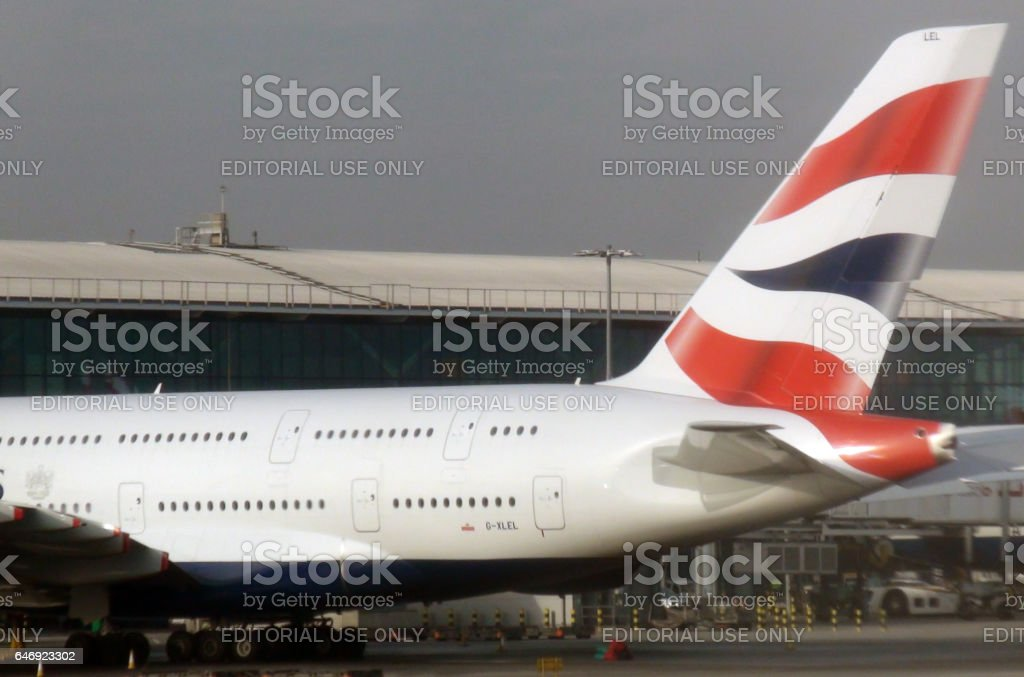 Tail Of British Airways Passenger Airplane Parked At Heathrow Airport London stock photo
