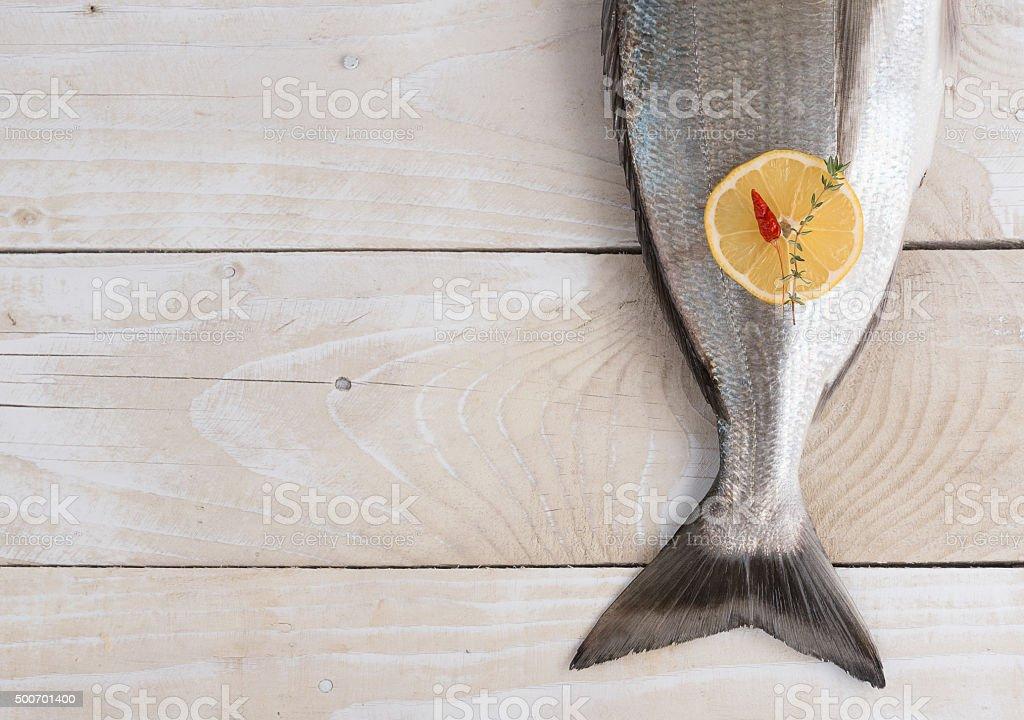 Tail of fresh dorado with spices stock photo