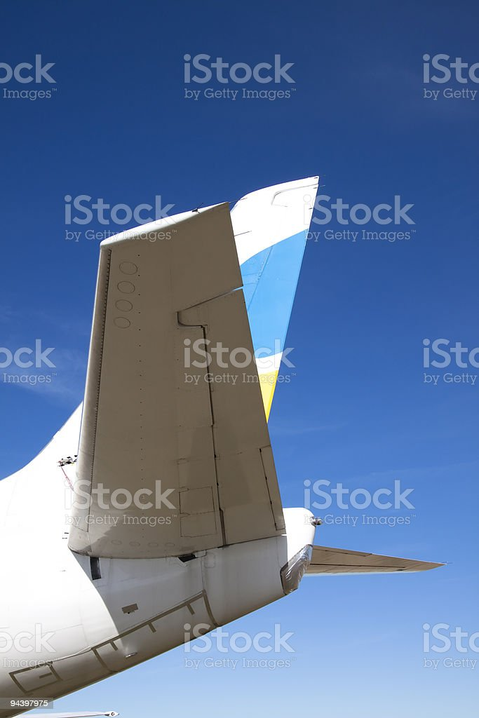 Tail Section of A Commercial Jet Airplane XL royalty-free stock photo