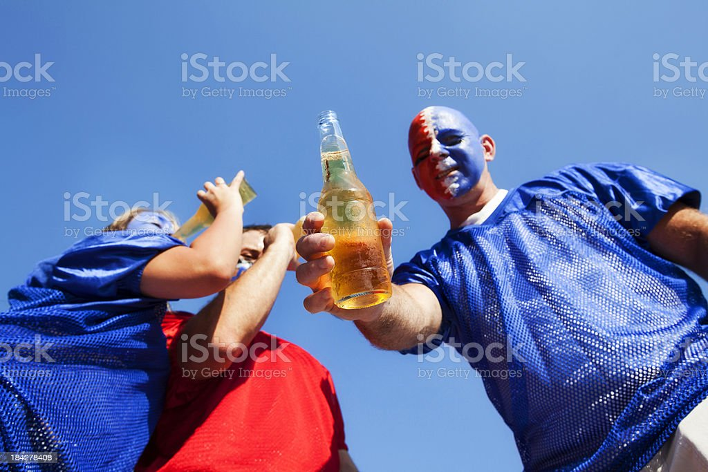 Tailgate party beer toast with friends and fans royalty-free stock photo