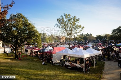 Mississippi State, Mississippi, USA - November 11, 2017: Fans tailgating in tents at the Mississippi State University versus The University of Alabama football game on the campus of Mississippi State near Davis Wade Stadium at Scott Field.