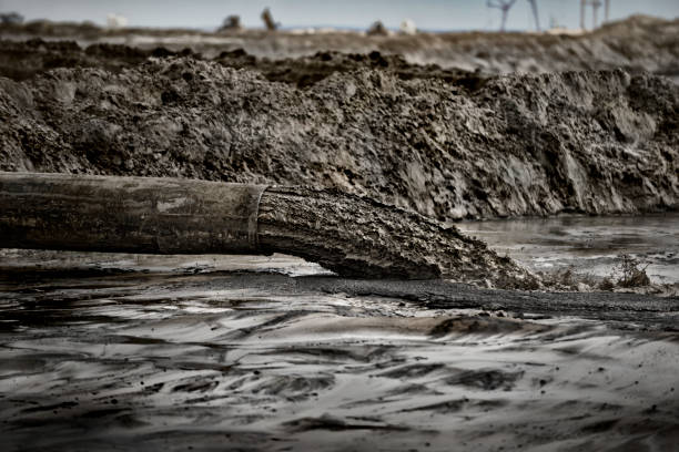 Tailings being dumped into a tailings pond stock photo
