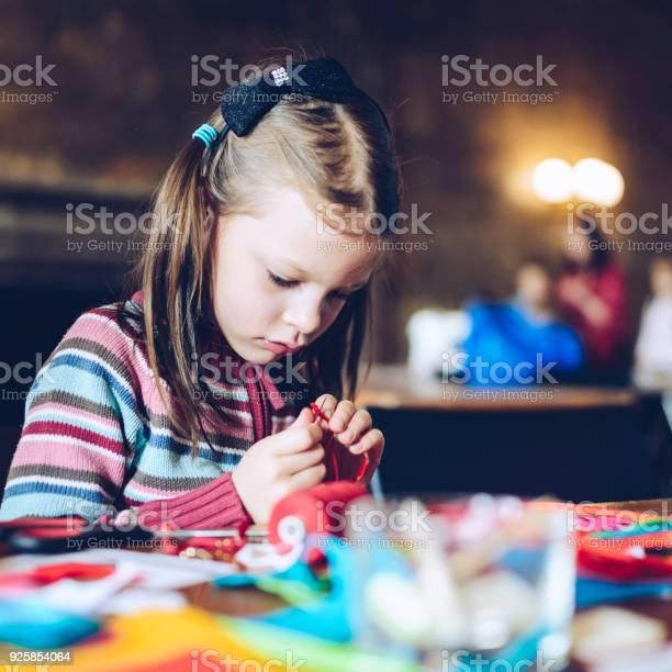 Tailor art workshops for children a girl sewing felt decorations picture id925854064?b=1&k=6&m=925854064&s=612x612&h=jpzbqixxezfzchzxnxubvn2o0nlrbwopdi neogiq m=