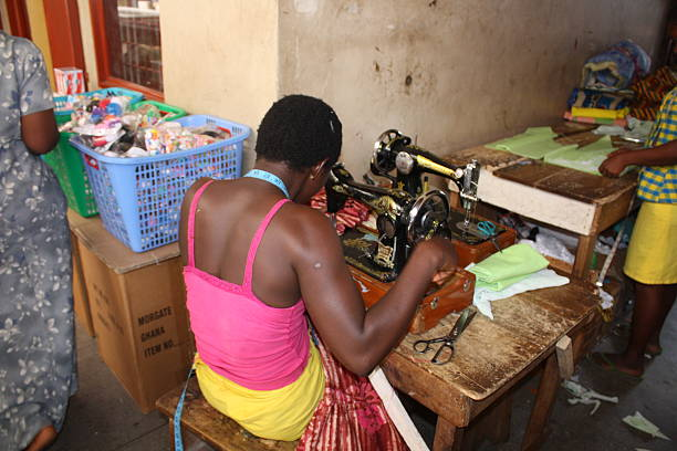 tailor at an old sewing machine in accra, ghana, - kente cloth stock photos and pictures