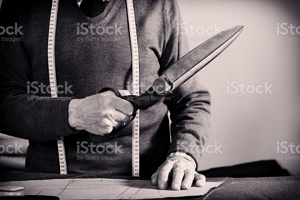A tailor at work  holding a pair of shears royalty-free stock photo