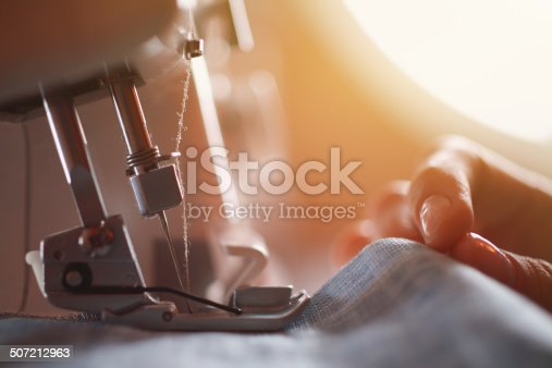 Tailor at Work on Sewing Machine.