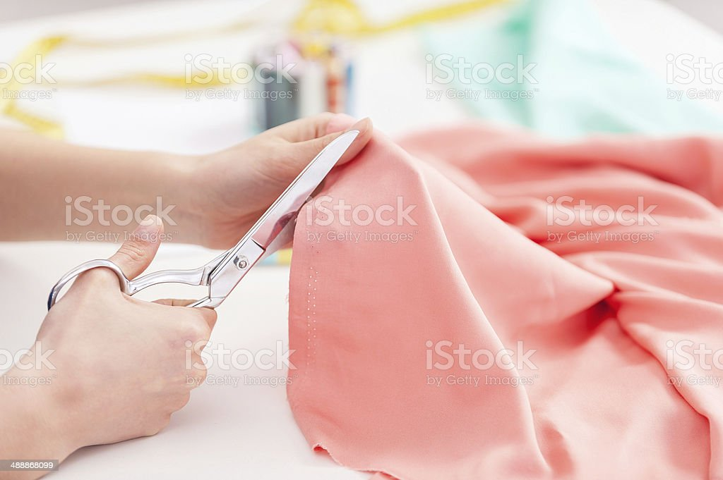 Tailor at work. stock photo