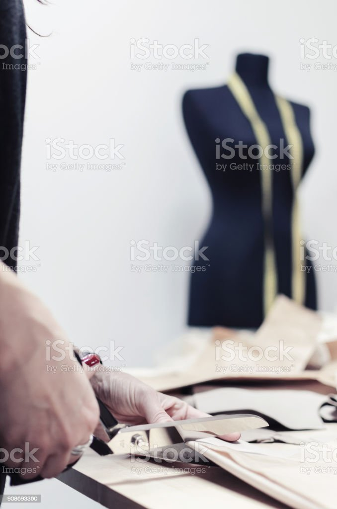 tailor cuts scissors stock photo