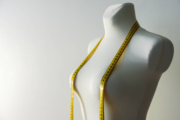 Tailor dummy with measuring tape
