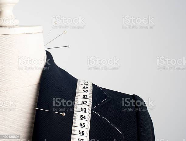 Tailor mannequin on white background.