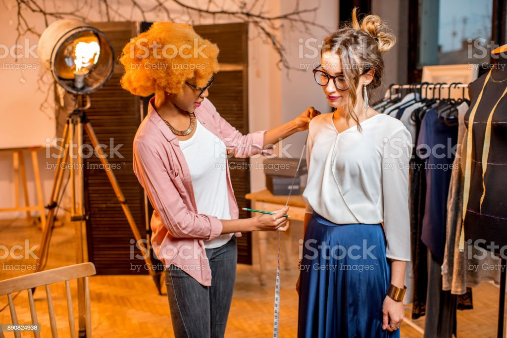 Tailor measuring woman client stock photo