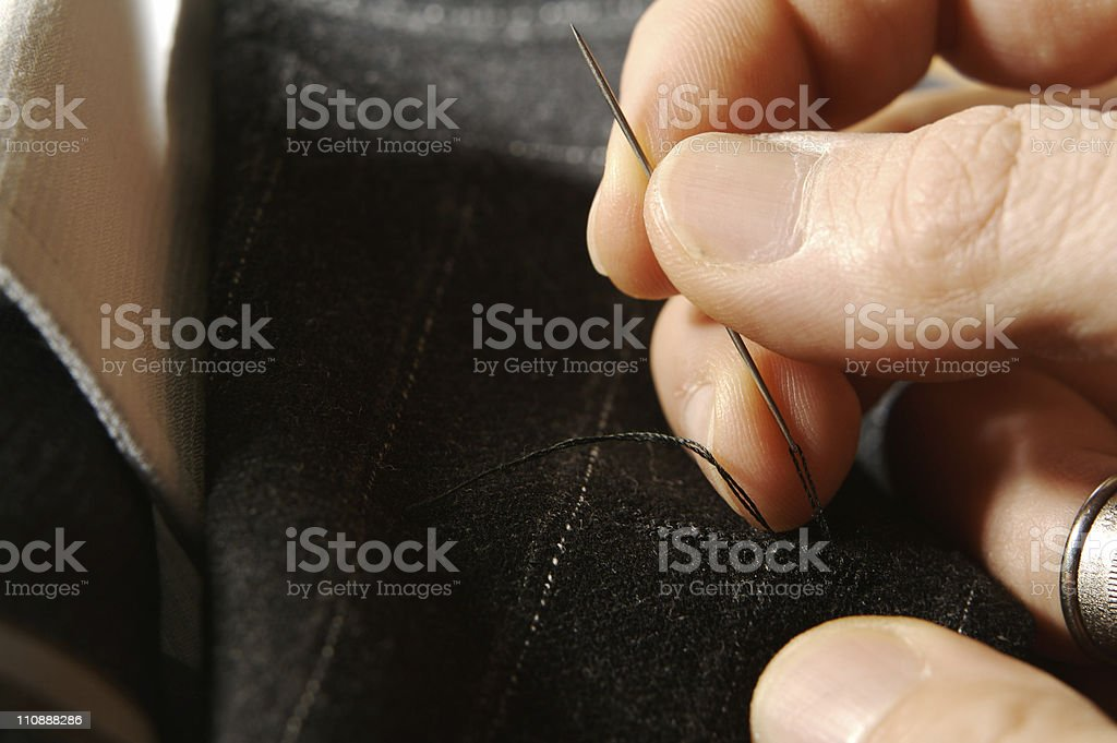 Tailor on business man [three] stock photo