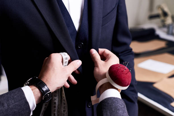 tailor pinning custom suit - customize stock pictures, royalty-free photos & images
