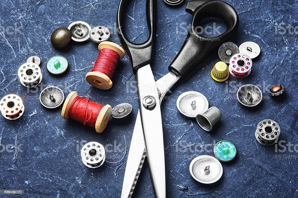 Tailor scissors and buttons stock photo